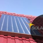 solar geyser, flat panel on red roof
